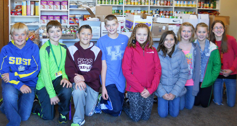 "Spearfish Middle School students collected and donated more than 600 food items -- along with $900 cash -- to the Spearfish Community Food Pantry in November 2013.  ""It was a wonderful thing, and the Middle School kids did a remarkable job,"" said pantry president Karen Miller.  ""We appreciate what they've done for the pantry and their community!""  The money will go toward buying lower-cost foods from the Rapid City Food Bank or from the several local food stores that have provided continuing support to the pantry over the years. <i>(Photo of Middle School council members is courtesy of the Black Hills Pioneer.)</i>"