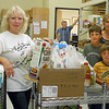 In all, Countryside collected 487 pounds of food that their members and church friends donated.<br /> <br /> And these Countryside volunteers helped move the donated foods onto the pantry shelves.<br /> <br /> Shown left-to-right are Coco Villard, Sam Schlabach, Wesley Schlabach, and Susan Schlabach.<br /> <br /> Storage volunteer Monte Stensland is in the background.