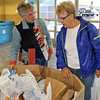 <b><i>WALMART FOOD DRIVE</i></b> - September 2011  Board members Cathy Inghram (left) and Karen Miller (right) survey just a few items of the huge amount of groceries donated by Walmart shoppers September 17th and 18th, 2011.