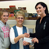 <b><i>THE BLACK HILLS STATE UNIVERSITY RODEO CLUB </i></b>recently sold some 419 calendars and contributed $1.00 from each sale to the Spearfish Community Food Pantry.  On Monday, March 18, 2012, Rodeo Club Captain Joey Painter (right) presented a check for $419 to pantry president Karen Miller.  Rodeo Club secretary Jamie Britton is at left.