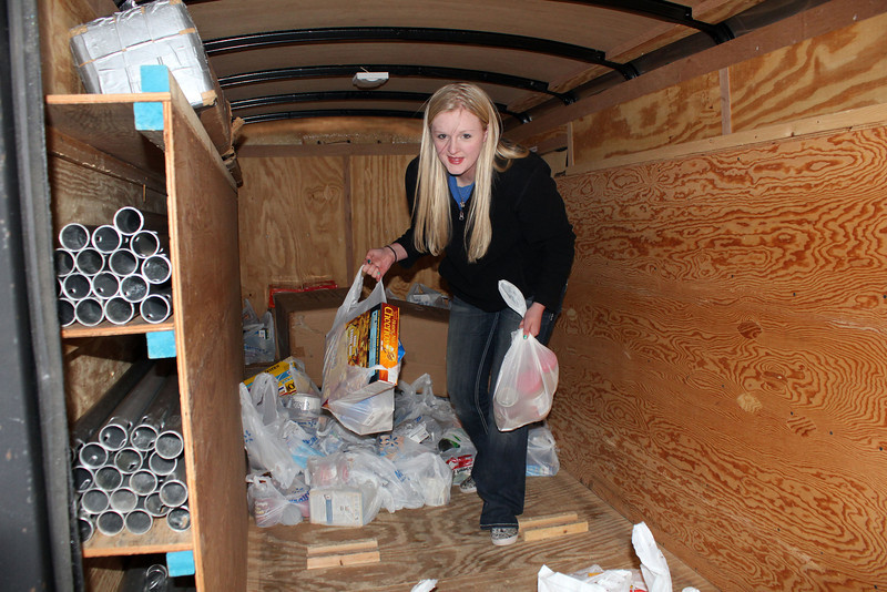 There's Jessie Cronk from BHSU helping unload all the food.