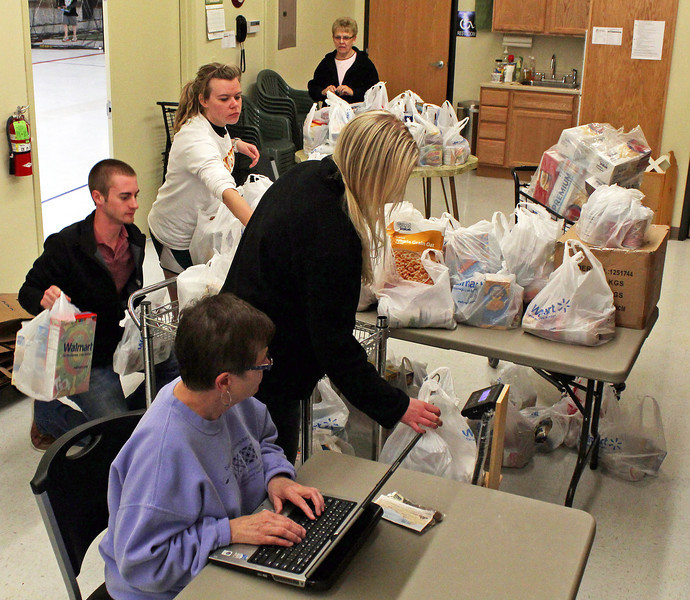The BHSU students at work, sorting and weighing the food from the food drive.  BHSU professor Verona Beguin tallies the numbers.
