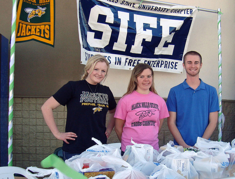 """<b><i>BHSU STUDENTS IN FREE ENTERPRISE (SIFE)</i></b> were more of our """"pantry heroes"""" this spring. Left-to-right:  students Jessie Cronk, Becca Ellis and Curtis Coomes stand by at the Spearfish Walmart store to receive donations for the first annual food drive conducted by the group on Saturday, March 17, 2012.  Remember, you can click on the photo and select a larger size image to view."""