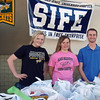 "<b><i>BHSU STUDENTS IN FREE ENTERPRISE (SIFE)</i></b> were more of our ""pantry heroes"" this spring. Left-to-right:  students Jessie Cronk, Becca Ellis and Curtis Coomes stand by at the Spearfish Walmart store to receive donations for the first annual food drive conducted by the group on Saturday, March 17, 2012.  Remember, you can click on the photo and select a larger size image to view."