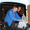 Perry Beguin and SIFE student Curtis Coomes begin unloading the food collected for the Food Pantry.