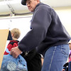 Volunteer Perry Beguin weighs one of the early-arriving bags of food during the 2011 Scout Food Drive in Spearfish.  Empty bags were delivered earlier in the week.  Scouts and other volunteers began picking up filled bags and delivering them to the Spearfish Community Food Pantry on Saturday, December 10th.