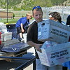 "Greg Krier and his family were among the volunteers from Countryside Community Church helping unload food during the ""Stamp Out Hunger"" food drive in May.<br /> <br /> At the end of the day, more than 2,400 pounds of food went on to pantry shelves -- thanks to the generosity of Spearfish residents and the good efforts of the U.S. Postal Service workers who collected the food."