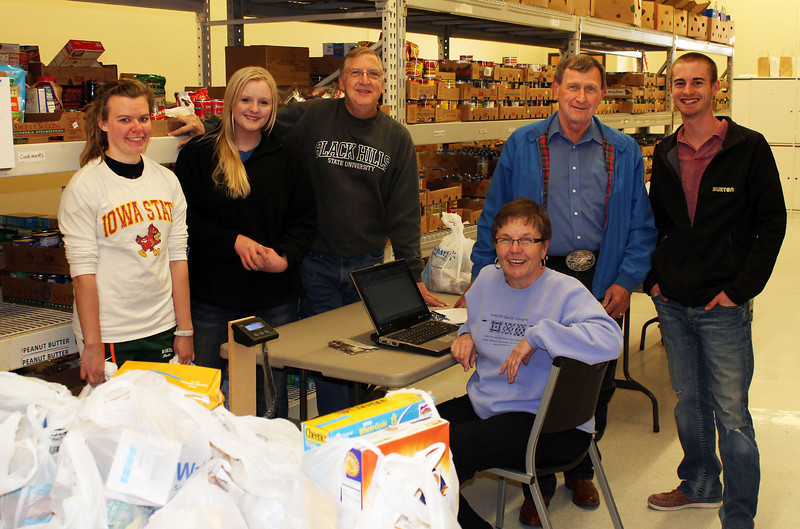 Taking a rest after unloading the food at the pantry. <br /> <br /> Left-to-right are BHSU students Becca Ellis and Jessie Cronk, Rotarians Steve Parker and Perry Beguin, student Curtis Coomes and -- seated at front -- BHSU Professor Verona Beguin, who often provides supervision for Perry Beguin.<br /> <br /> Click on the image and you can get a closer look at this happy group!
