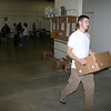 <b><i>BOY SCOUT FOOD DRIVE</i></b> - December 12, 2009  After sorting the food, volunteers carried the food into the Food Pantry storage area.