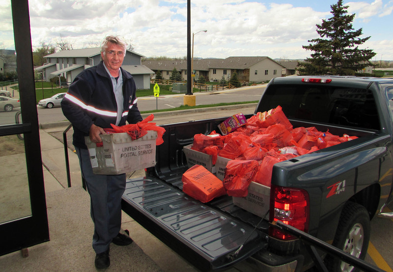 <i>STAMP OUT HUNGER</I> - Saturday, May 10, 2014  Postal worker Alan Hrdlicka unloading another truck of food from our wonderful donors throughout the community.
