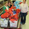 <i>STAMP OUT HUNGER</I> - Saturday, May 10, 2014  Taking a short break are pantry volunteers (left-to-right) Karen Miller, Twila Suwyn, and Deb Martius.