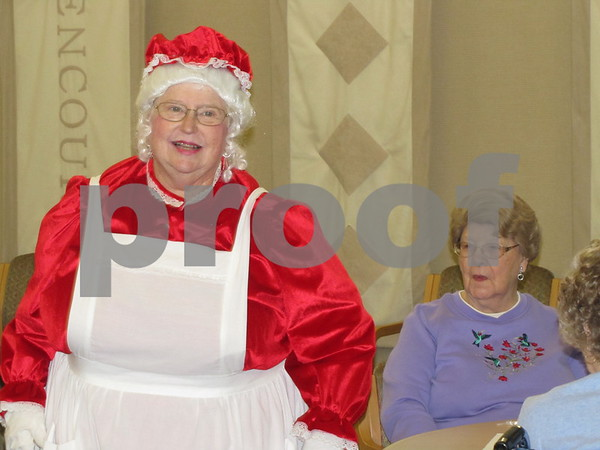 Ruth Bennett as Mrs. Claus, handed out candy canes between sets of her piano playing.