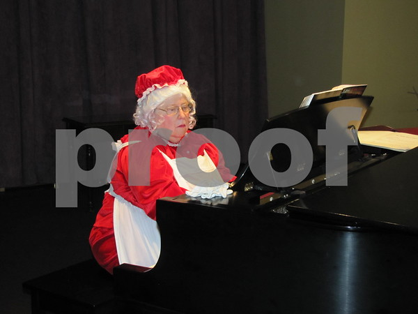 Ruth Bennett played holiday music on the piano at the party to celebrate the 10 year anniversary of The Gardens.