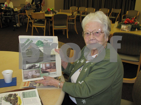 Wanda Clark, resident of Friendship Haven, shows some of the original articles she has collected about the building and opening of The Gardens.