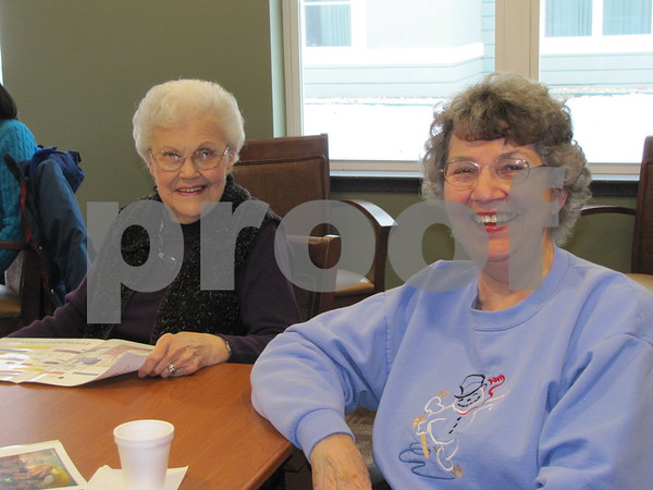 Leola Mundt and Mary Casey enjoy refreshments while attending the open house at Simpson Health Center at Friendship Haven.
