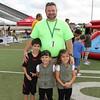 Event volunteer and three children.