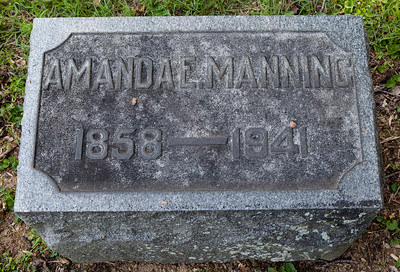 Amanda E. Manning, 1858 - 1941.   Stone next to Julius A. Manning, 1843 - 1912.