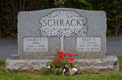 Tombstone of Charles A and Meda (E. Nee Clauser) Schrack.