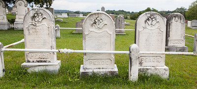 Left stone:  Theetta (Theeta) Schock, 19 Nov 1856 - 20 Nov 1894, daughter of Jesse and Rebecca (Himmelberger) Schock.  Middle stone: Jesse Schock, 30 Oct 1818 - 12 May 1893, son of Michael Schock and Elizabeth Nunemacher. His first wife was Maria Philips, no known children. His second wife was Rebecca Himmelberger.  Right stone: Rebecca (Himmelberger) Schock, 26 Feb 1825 - 19 Apr 1882.   Jesse and Rebecca had 3 known children; Theeta, Emerson F. and Ellen L. Schock.  Back stone: Ellen Wieser (?),  wife of Franklin Stoudt. Feb 12, 1855 - July 25, 1885, aged 30 years….