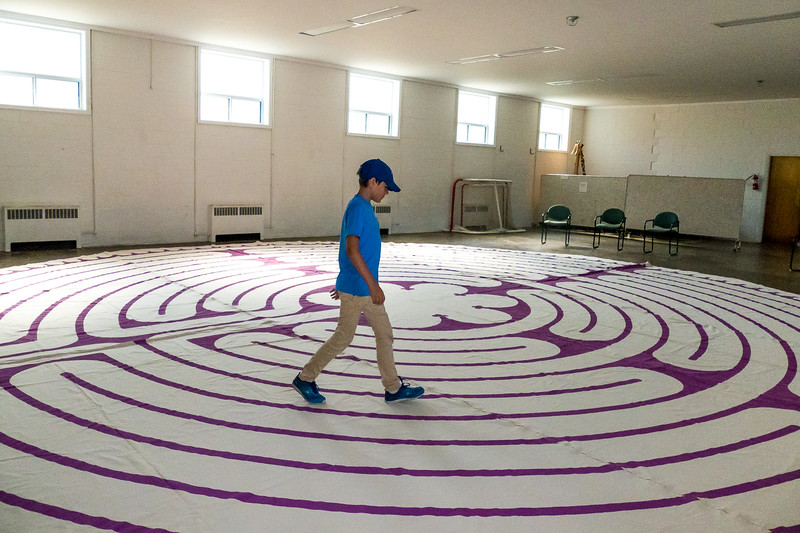 """A large labyrinth was set up in the lower level with a """"contemplative"""" central zone."""