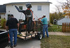 Carroll Goodsell provided his trailer for moving the artwork.  Here, Todd Carlson, Chris Anderson and Carroll tie the sculpture firmly to the trailer.