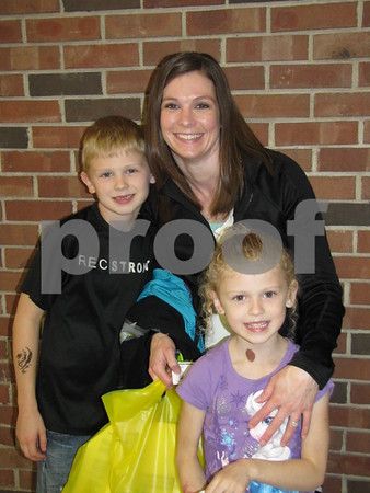 Stephanie Hanson and her children Jace and Averie pose while taking a break from all the action at Kidzmania.