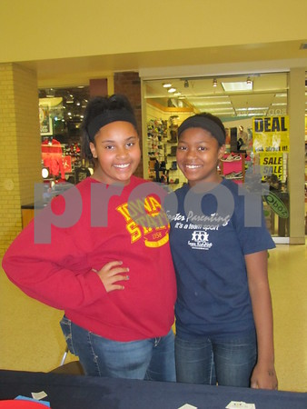 Makayla Naylor and Shareece Smith were volunteers at the booth for Foster Parenting.
