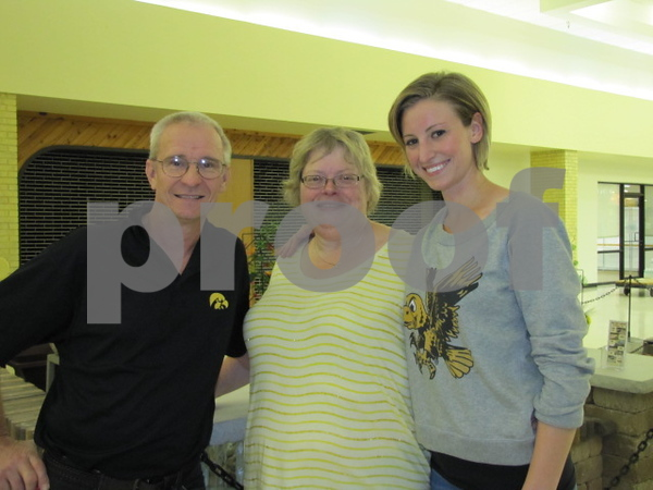 Gary and Jane Moeller with their daughter Jenna Hadley.  Hadley's husband was Hurky the Hawk for the day at Kidzmania.