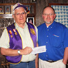 The good folks at Lynn's Dakotamark raised some $266 for Lion's projects.  Here, Dakotamart Manager Jim Grapentine (right) presents a check for that amount to our trusty Treasurer, Rich Drabek.  Many thanks to Lynn's Dakotamart!