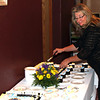 29 Oct 2011<br /> Barb Moser of the Mulligan cuts the cake!
