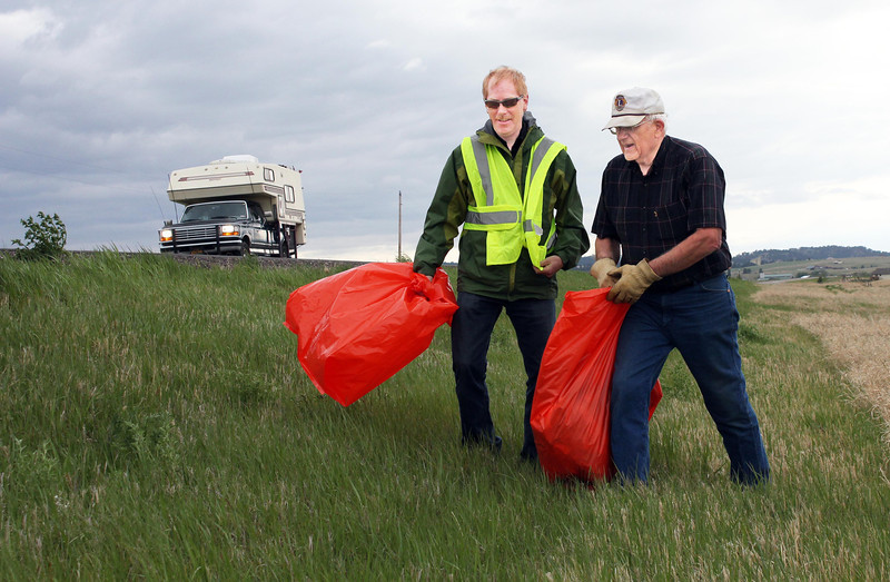 "Lions Brian Kline and Rich Drabek team up along the north side of U.S. 34 during the May clean-up project.           Return to <a href=""http://www.bellefourchelions.org/""><b><i>Belle Fourche Lions Club</i></b></a> web site."