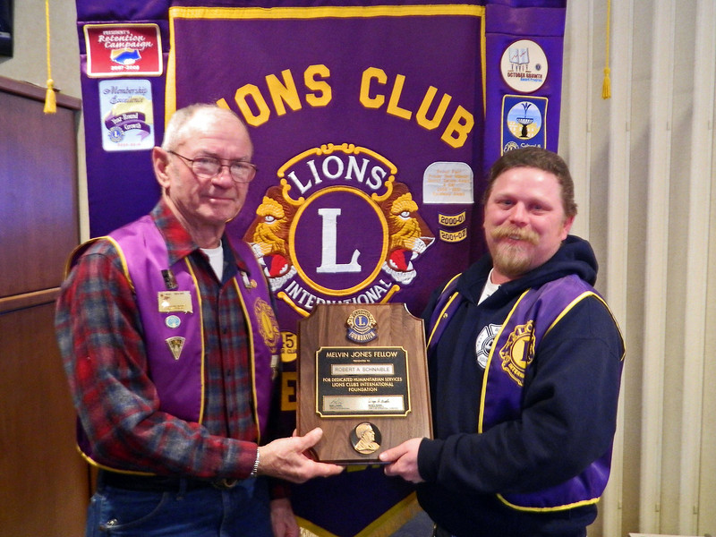 <b>SCHNAIBLE IS MELVIN JONES FELLOW</b> 23 January 2014  Lions Clubs worldwide recognize outstanding individuals by bestowing on them an award that is named for its founder, Melvin Jones.  It  is the highest form of recognition and embodies humanitarian ideas consistent with the nature and purpose of Lionism.    We're proud to recognize fellow Belle Fourche Lion <b>Bob Schnaible</b> as a recipient of this prestigious award.  Lion Schnaible (left) was presented the award on January 23, 2014 by club president Rik Bartels.  (Photo courtesy of Lion Ron Ensz)