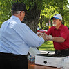 Del Neumeister serves with a smile during the 24th All Car Rally in Belle Fourche.  As always, Lions served burgers, brats, doughnuts and other delights.