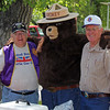 Lions Mike and Leo with Smokey the Bear.