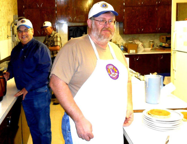A glimpse of behind-the-scenes work in the kitchen.  Shown are Lions Ron Ensz (left) and Rick Walton.  Lion Tim Cleveland is in the background.