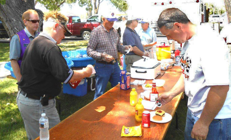 Lions Kline, Keil, and Orme on the serving line during the All Car Rally in June 2012.