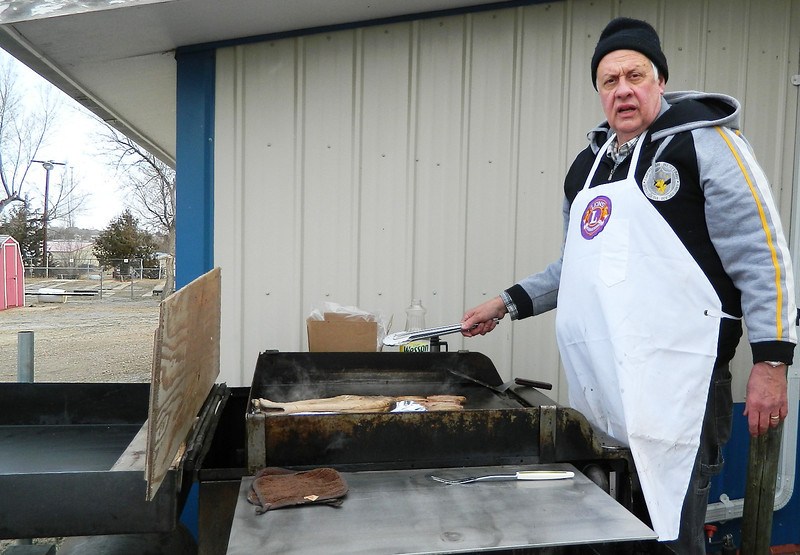 Lion Tom Nary braved the cold to ensure that ticket-holders got the sausage to go with their all-you-can-eat pancakes!