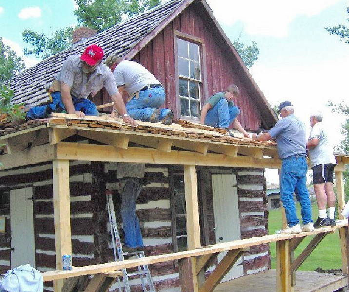 """Belle Fourche Lions building a new porch on the Johnny Spaulding cabin.  Among the crew are Jim Osloond, Rick Walton, Ian Walton, Rich Drabek, and Tom Nary.             Return to the home page of the <a href=""""http://www.bellefourchelions.blogspot.com""""> Belle Fourche Lions</a>."""