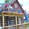 "Belle Fourche Lions building a new porch on the Johnny Spaulding cabin.  Among the crew are Jim Osloond, Rick Walton, Ian Walton, Rich Drabek, and Tom Nary.             Return to the home page of the <a href=""http://www.bellefourchelions.blogspot.com""> Belle Fourche Lions</a>."