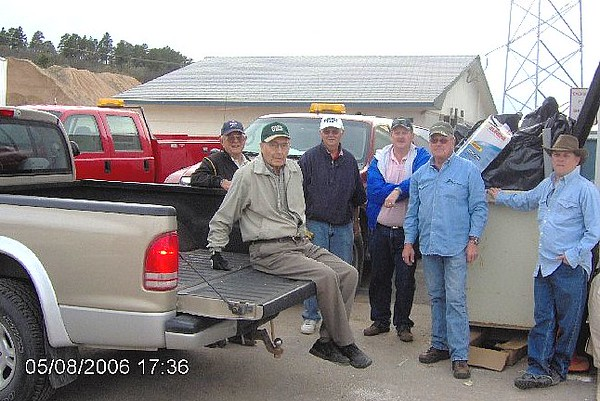 Belle Fourche Lions work to keep trash off the roadside along Highway 34 west of town.  Here, a pick-up team takes a break after cleaning up the 2-1/2-mile stretch a few summers ago.  Shown are Lions Al Shaw, Bill Dick, Lee Voyles, John Cooper, Harry Haivala (team chief) and Rik Bartels.