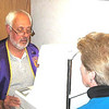 <b><i>LIONS CLUB ACTIVITIES</i></b>  Lion Tom Nary conducting an eye test during a recent health check-up program.  Among other tests conducted by Lions members at these events are diabetes, blood pressure, and hearing.