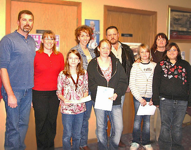 """2008 Peace Poster Contest winners.  Among the winners are Emily Suwyn, Megan Street, and Akela Gross, shown here with some of their family members.            <b>Return to <i> <a href=""""http://www.bellefourchelions.org"""">Belle Fourche Lions</a> web site</i></b>"""