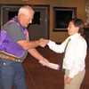 Sixteen Belle Fourche Middle School students entered the 2010 Peace Poster contest, which was judged by Belle Fourche artist Mick Harrison and high school art teacher Linda Rothermel, <br /> <br /> Here, during the November 11, 2010 Lions meeting, Treasurer Rich Drabek congratulates first place winner Nicholas Peterson and presents him with a $50 check.