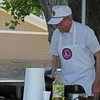 Fresh from an engagement as chef during the recent pancake feed, Lion Bob Schnaible dons the cooking apron for another job.