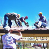Lions work on one of the Belle Fourche picnic shelters.  Atop the roof (left-to-right) are Rick Walton, Jim Osloond, and Chuck Snoozy.
