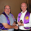 Following the installation of officers held on September 8, 2011, outgoing president Ron Ensz (left) passed the gavel to the new president of the Belle Fourche Lions Club, Brian Kline.