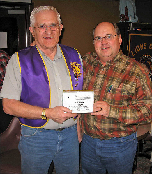 On March 25, 2010, Belle Fourche chapter Vice-President Ron Ensz (right) presented Lion Rich Drabek with an award from the Lions Foundation, reflecting Rich's continuing support for the foundation and its activities.  Rich continues his good work as Treasurer for the Belle Fourche Lions Club.  Congratulations, Rich!