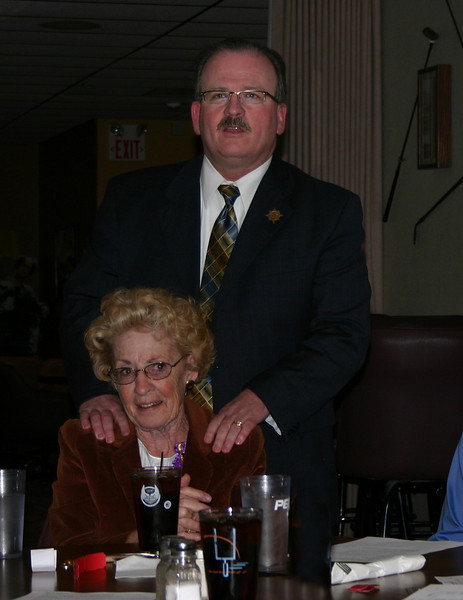 "Two visiting Lions from the Northern Lights Lions Club -- Kelly Walton and Joyce Drabek -- visited our group on May 13th.  Here, Lion Bob Morris provides his own unique style of welcoming to Joyce Drabek.             <b>Return to <i> <a href=""http://www.bellefourchelions.org"">Belle Fourche Lions</a> web site</i></b>"