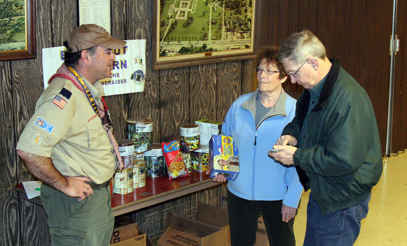 Cubmaster Allan Schreier was on hand early in the morning to man the popcorn sales that benefit the scouts.