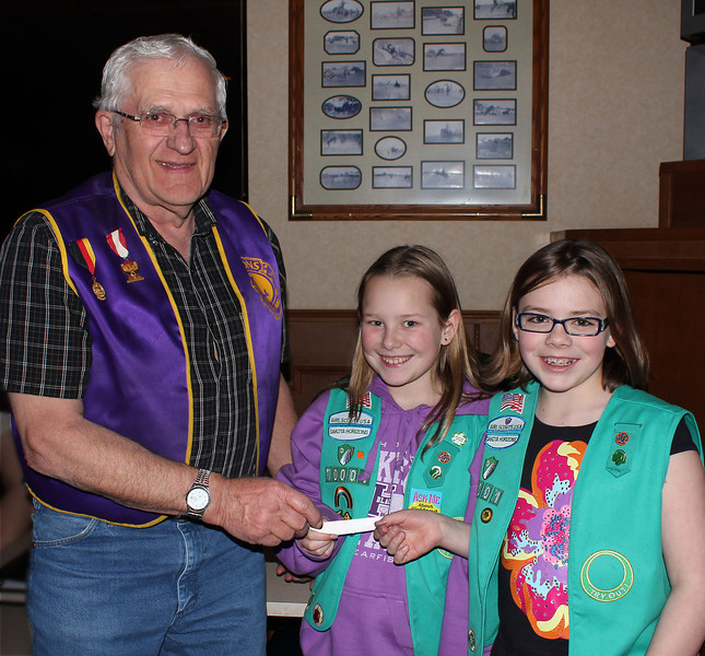"LIONS SUPPORT SCOUTS <i><b>""OPERATION TASTE OF HOME""</I></B>  Lions Club treasurer Rich Drabek presents a $50 check to Junior Girl Scout Troop 70001 of Belle Fourche for ""Operation Taste of Home"" during the February 28th, 2013, Lions meeting.  Accepting the check are scouts LeeAna Best (center) and Seyara Sechser (right).  The money will allow the troop to send a case of Girl Scout Cookies to military personnel serving overseas.  The Junior Girls Scouts also use money collected from cookie sales for a variety of community service projects -- like the ""Pretty the City"" project that provided for the planting of flowers at Herrmann Park.  This year, they hope to help plant more trees along the River Walk."
